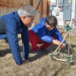 Professor Dad and Akshay building a catapult